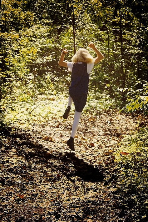 Taylor Jumping in the Woods LR