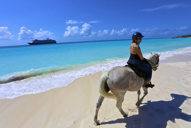 Wendy walking her horse on the beach. We ultimately regretted our horseback riding excursion.