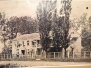 An early photo of the Scholte's house. It was the first house built in Pella and now stands as a museum on the north side of the square.