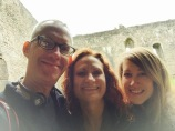 Tom, Wendy, and Taylor's selfie in front of courtyard of Doune Castle.