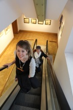 Taylor and Wendy ride the escalator at Edinburgh's City Art Centre.