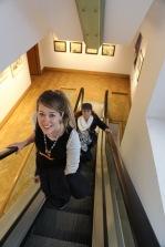 Taylor and Wendy ride the escalator at Edinburgh's City Art Centre.