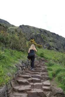 Taylor climbing the long, rock stair up Arthur's Seat.