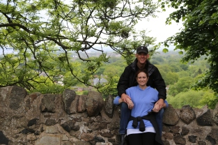 Sitting on an old stone wall in Holy Rood Park, Edinburgh, Scotland.