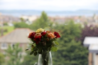A bouquet of roses that Taylor's flatmates gave her in welcome adorns her bedroom window.