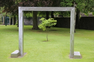 A tree framed by sculpture outside the Scottish National Gallery of Contemporary Art Two.