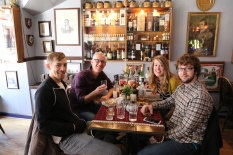 A toast to whiskey tasting with good friends at Rabbie Burns Pub.