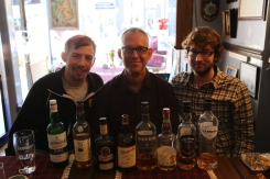 Tom with Jon De Haan, Gabe Spencer, and eight very good Scotches at Rabbie Burns' Pub on the Royal Mile, Edinburgh.