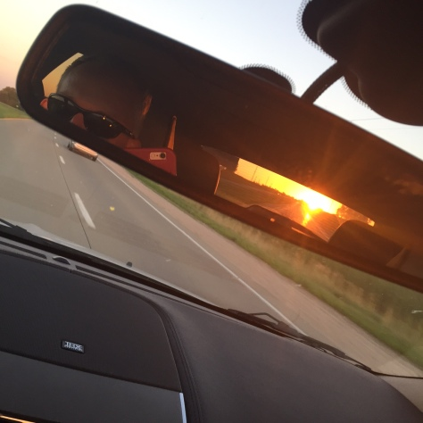 You know it's been a long day on the road when you watch the sunset in your rear view mirror!