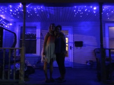 Taylor and Wendy on the porch at Catholic Worker House where she lives.