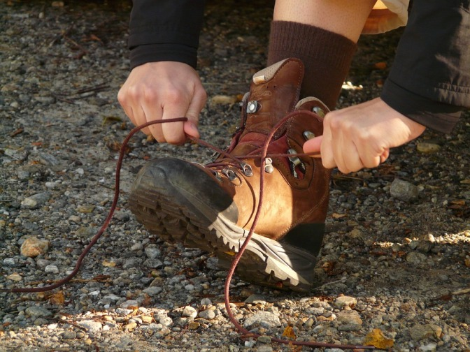 lacing up a hiking boot