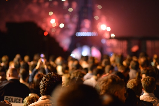 people-eiffel-tower-lights-night-medium