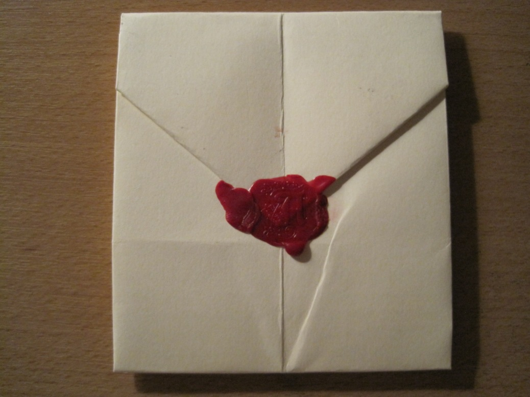 Wax_seal_with_impression_of_uppercase_letter_A