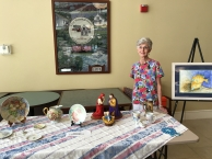 Grandma Jeanne showing off her artwork at their community.
