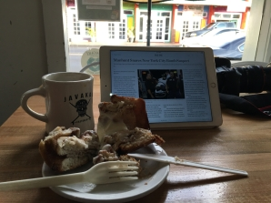 Coffee, cinnamon roll, and the Wall Street Journal at Java Kai.