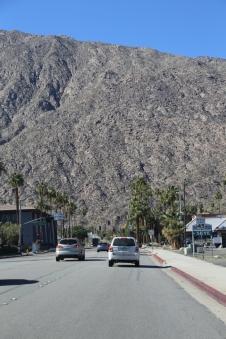 Mountains loom over Palm Springs like a giant wall.
