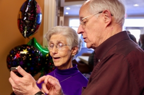Dad showing mom Madison's text message with birthday wishes.