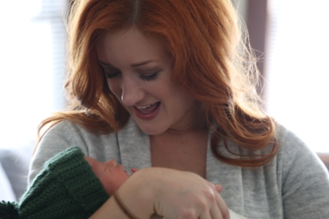 Madison holds her nephew, Milo, for the first time.