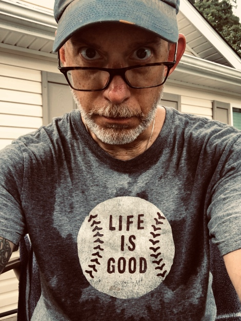 Life is good, even working up a sweat mowing.